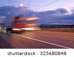 truck on a highway in the night | Shutterstock . vector #325680848