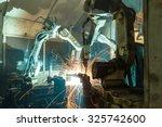 team welding robots represent... | Shutterstock . vector #325742600
