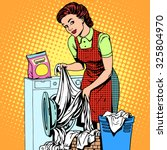 A Woman Washes Clothes In A...