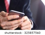 businessman with mobile phone | Shutterstock . vector #325857560