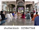 Small photo of THIRUVANNAMALAI, TAMILNADU, INDIA, SEPTEMBER 21, 2015: Ramanasramam. Visitors and devotees sitting on the floor attend pooja and mantra chanting in the morning. The shrine is seen in the background.