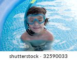 child in the pool on holiday... | Shutterstock . vector #32590033