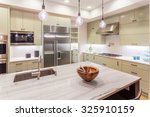 Stock photo kitchen interior detail with island sink cabinets and hardwood floors in new luxury home 325910159