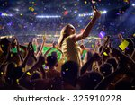 fans on stadium game  | Shutterstock . vector #325910228