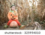 child celebrating halloween | Shutterstock . vector #325954010