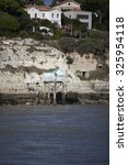 Small photo of traditional french fisherman's wooden hut at the bottom of the limestone cliff in the estuary of Gironde, Meschers-sur-Gironde, France