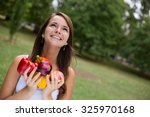 happy young woman holding food