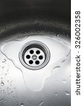 Water Drops Around Plughole