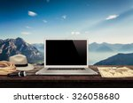 white laptop map hat rope torch ... | Shutterstock . vector #326058680