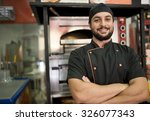 turkish man posing near to oven  | Shutterstock . vector #326077343