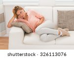 portrait of young woman sitting ... | Shutterstock . vector #326113076