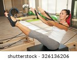 girl is exercising pilates... | Shutterstock . vector #326136206