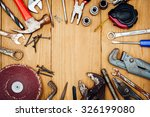 many tools on wooden background | Shutterstock . vector #326199080