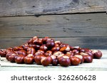 Many Chestnuts On A Wooden...