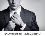 businessman fixing his tie.    Shutterstock . vector #326285840