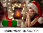 Funny Smiling Child In Santa...