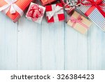 christmas gift boxes on wooden... | Shutterstock . vector #326384423