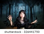 Young Girl Dresses As A Witch...