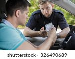 policeman checking young male... | Shutterstock . vector #326490689