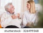 photo of volunteer in care home ... | Shutterstock . vector #326499368