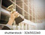holding trophy awards after... | Shutterstock . vector #326502260