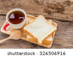 slice of bread and tea in... | Shutterstock . vector #326506916