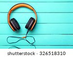headphones on wooden background | Shutterstock . vector #326518310