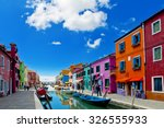 colorful houses at daytime in... | Shutterstock . vector #326555933