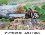 Chainsaw On A Stump Of A...