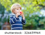 Funny Little Kid Boy With Appl...