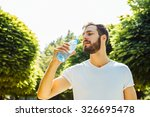close up of a man drinking... | Shutterstock . vector #326695478