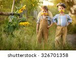 two boys try on his mustache ... | Shutterstock . vector #326701358