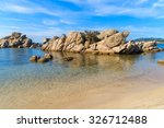 rocks in sea water on... | Shutterstock . vector #326712488