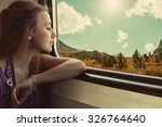 young woman traveler sitting in ...   Shutterstock . vector #326764640