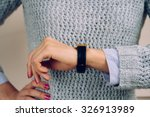 Woman In A Gray Sweater Checks...