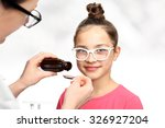 Small photo of A child with a doctor, a cure for the flu.Your child is taking a drug administered on a spoon.