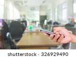 hands holding mobile phone with ... | Shutterstock . vector #326929490