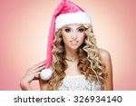 young lady in christmas hat on... | Shutterstock . vector #326934140