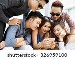 group of teenagers watching