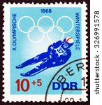 """Small photo of GERMAN DEMOCRATIC REPUBLIC - CIRCA 1968: A stamp printed in Germany from the """"Winter Olympic Games, Grenoble """" issue shows Luger, circa 1968."""