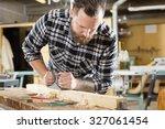 hard working craftsman working...   Shutterstock . vector #327061454