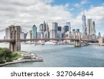 Small photo of View of Brooklyn Bridge and Manhattan skyline - New York City downtown, photographed from Manhattan Bridge