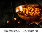 plate with fresh sea buckthorn... | Shutterstock . vector #327100670