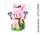 cute rabbit ringing christmas...   Shutterstock .eps vector #327119840