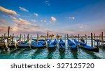 gondolas in venice   sunset... | Shutterstock . vector #327125720