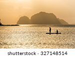 Two Silhouettes Fishing In The...