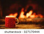 cup of hot drink in front of... | Shutterstock . vector #327170444