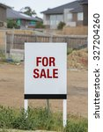 for sale sign on a vacant... | Shutterstock . vector #327204260