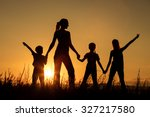 happy family standing in the... | Shutterstock . vector #327217580