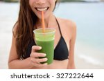 green smoothie. woman holding... | Shutterstock . vector #327222644
